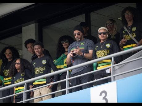 File Reggae Girlz ambassador Cedella Marley (centre in shades) stands during the playing of Jamaica's National Anthem at the Reggae Girlz's first round match against Italy at the 2019  FIFA Women's World Cup.