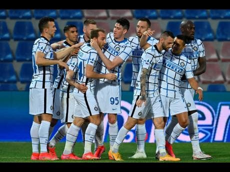 Inter Milan's Christian Eriksen (fourth form left) celebrates after scoring his side's first goal during the Italian Serie A match against Crotone at the Ezio Scida Stadium in Crotone, Italy, on Saturday.