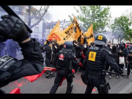 """Police and demonstrators clash during the """"Revolutionary May Day Demonstration"""" in Frankfurt on Saturday."""