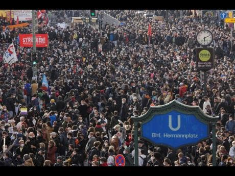 Thousands of protestors attend a May Day rally at the Hermannplatz square in Berlin, Germany on Saturday.