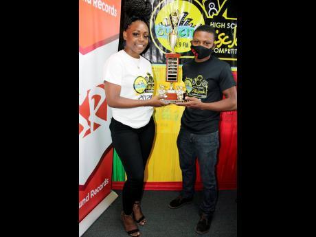 Last year's SunCity 104.9 FM high-school disc jock title holder Venece 'DJ Venny' Beckford (left) hands over the trophy to the 2021 winner, Javain 'DJ Jay Jay Badness' James.