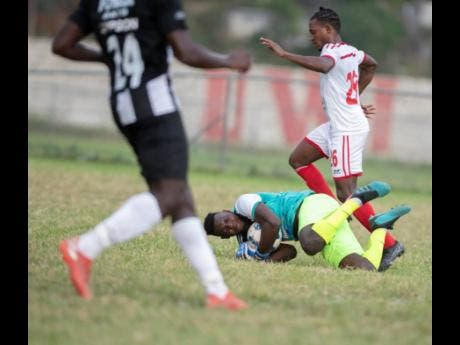 File Cavalier FC goalkeeper Jeadine White secures the ball to repel an attack by UWI FC in Red Stripe Premier League on February 23, 2020.