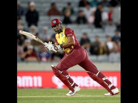 West Indies T20 captain Kieron Pollard runs between the stumps during their first match against hosts New Zealand at Mount Maunganui in November 2020.
