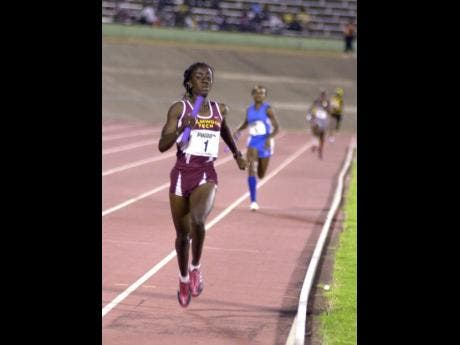 Sonita Sutherland anchors Holmwood Technical High School 4x400m relay team to victory at Champs 2006.