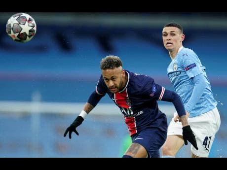 Manchester City's Phil Foden (right) challenges PSG's Neymar during the Champions League semi-final second-leg match between Manchester City and Paris Saint-Germain at the Etihad stadium, in Manchester, Tuesday, May 4, 2021.