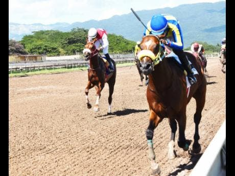 File TRICKY ONE (on the rails), ridden by Oshane Nugent, wins the PICK3 Simple Ting Fi Win Trophy (third race) at Caymanas Park on Sunday, November 29, 2020.