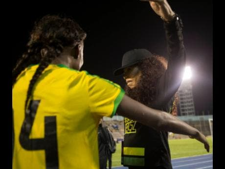 FILE A proud and emotional Cedella Marley opens her arms to embrace Reggae Girl Deneisha Blackwood moments after the team's victory in the international friendly against Panama.