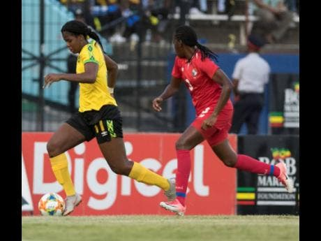 FILE Reggae Girl Khadija Shaw dribbles away from Panama's Maria Murilo in a international friendly match played at the National Stadium in Kingston on Sunday May 19, 2019.