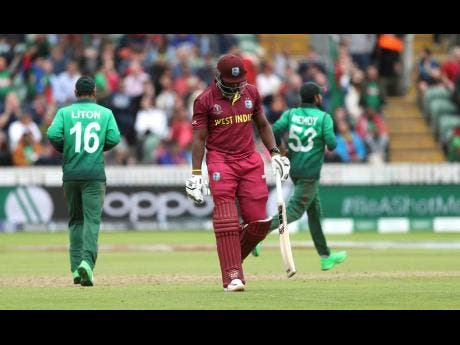 West Indies' Andre Russell walks off the field after being dismissed during the Cricket World Cup match between West Indies and Bangladesh at The Taunton County Ground, Taunton, south west England, Monday June 17, 2019.