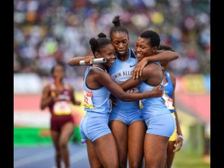 File Edwin Allen High's girls celebrate their win in the  1600m sprint medley open at the 2019 ISSA/GraceKennedy Boys and Girls' Athletics Championships.