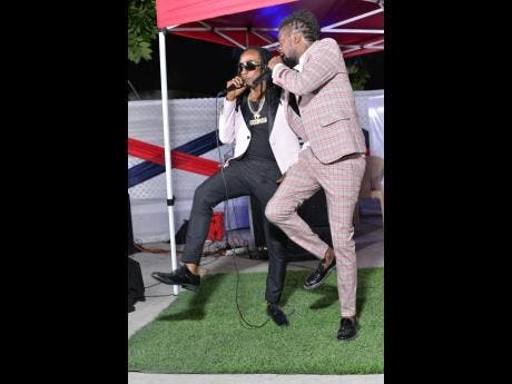 Twinkle Brain (left) performs with Beenie Man. The up-and-coming dancehall artiste said that he was overwhelmed that Beenie Man had turn up in person at his album [EP?] launch to show his support.