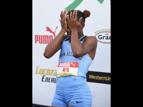 Edwin Allen's Tina Clayton is grief-stricken despite winning the Class Two Girls 100m final at the ISSA/GraceKennedy Boys and Girls' Athletics Championships at the National Stadium on Thursday. This is because her twin sister Tia, whom she was expected to complete the one-two with for her school, was disqualified after a false-start.