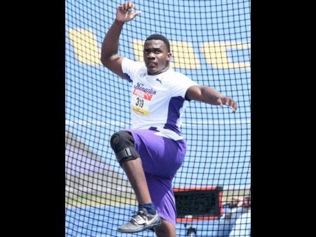 Kingston College's Ralford Mulling competing in the Class One boys discus event at Champs 2021.