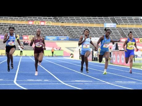 Shakeira Bowra (left) of St Catherine High taking fourth spot in the Class One girls 100 metres final during the 2021 ISSA/GraceKennedy Boys and Girls' Championships held May 11-15 at the National Stadium. The event was won by Edwin Allen High's Brandy Hall (centre). Also in photograph (from right) are Salieci Myles of Rusea's High (7th), Hydel High's Shenese Walker (2nd) and Sashieka Steele of Holmwood Technical, who placed third.