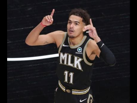 Atlanta Hawks guard Trae Young reacts during Game 4 of an NBA basketball first-round play-off series against the New York Knicks in Atlanta yesterday.