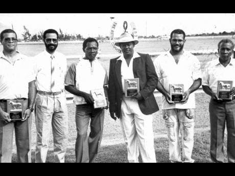 """MILLION-DOLLAR MILESTONES: Caymanas Track Limited's  Racing Secretary, Haleem Phillipps (2nd left) presented commemorative plaques to five Caymanas Park trainers who attained million-dollar career milestones in 1991. They are (from left) Godwin """"Bunny"""" Bucknor, Charles Morrissey (third left), Enos Brown, Richard Todd and Sydney Watson."""