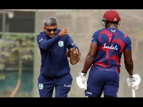 CWI Photo West Indies batting coach Monty Desai (left) and Rovman Powell.