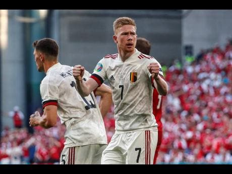 Belgium's Kevin De Bruyne reacts after Thorgan Hazard scored during the Euro 2020 championship group B match between Denmark and Belgium, at the Parken stadium in Copenhagen, yesterday. Belgium won 2-1.