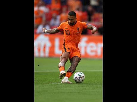 Memphis Depay of the Netherlands scores his side's first goal on a penalty during the Euro 2020 championship group C match between Netherlands and Austria at Johan Cruyff ArenA in Amsterdam, Netherlands, yesterday. The Netherlands won 2-0.