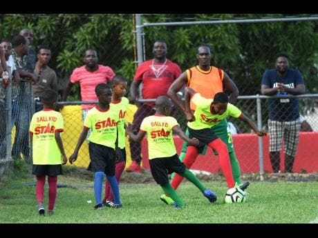 Ball Kids play during the half-time break of a local Premier League encounter at the Effortville Community Centre on Sunday, October 21, 2018.