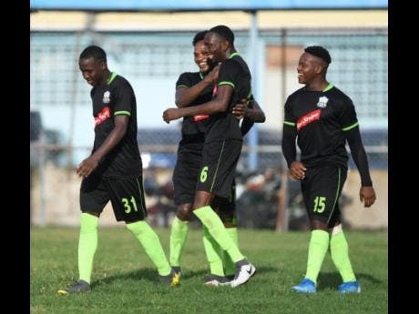Molynes United players (from left) Fakibi Farquharson, Damion Thomas, Jeremy Nelson and Ryan Brown celebrating a goal against  UWI FC during a Jamaica Premier League match at Waterhouse Stadium on Sunday, September 8, 2019.