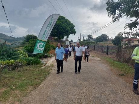 Audley Shaw (left), minister of industry, investment  and commerce, and member of parliament for  Manchester North East, and Yago Castro, managing director of Carib Cement, at the opening ceremony for the recently done Denham Farm road in Manchester.