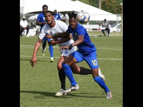 Molynes United's Nicholas Nelson (right) tussles with Mount Pleasant's James Liston in their Jamaica Premier League (JPL) match at the UWI/JFF Captain Horace Burrell Centre of Excellence on Sunday afternoon.