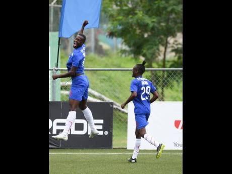 Portmore United's Chevany Willis (left)  jumps to celebrate his goal against Humble Lion at the UWI/Captain Horace Burrell Centre of Excellence yesterday. At right is his teammate  Taja Brown.