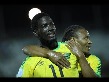 Shamar Nicholson (left) celebrates with Bobby Reid after scoring a goal in the Concacaf Nations League against Antigua and Barbuda on September 6, 2019. Nicholson will lead Jamaica's lines in World Cup qualifying action against Mexico.