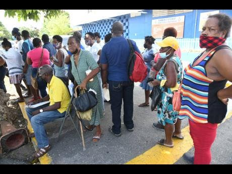 Residents of Tivoli Gardens in West Kingston turned out to get their COVID-19 vaccine at Tivoli Gardens High School on Thursday.