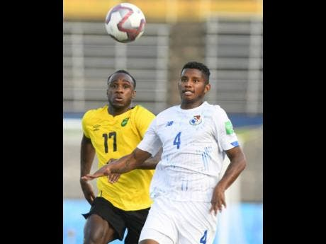 Jamaica's Michail Antonio (left) pursues Fidel Escobar Mendieta of Panama during the Concacaf  World Cup qualification match at the National Stadium on Sunday, September 5.