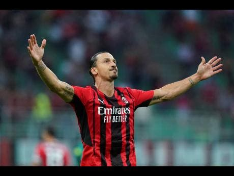AC Milan's Zlatan Ibrahimovic celebrates after scoring  his side's second goal during the Italian Serie A match against Lazio at the San Siro stadium in Milan, Italy on Sunday.