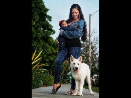 Samantha J with son Trillion and their pet dog Hulk. She is uncertain what to do with the animal now.