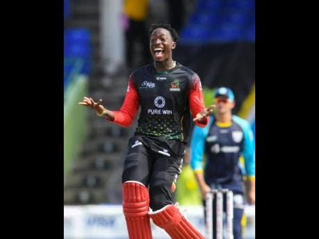 Domnic Drakes of Saint Kitts & Nevis Patriots celebrates winning the 2021 Hero Caribbean Premier League Final at Warner Park Sporting Complex yesterday.
