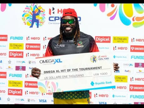 Chris Gayle of St Kitts & Nevis Patriots poses with the Hit of the Tournament cheque at the end of the 2021 Hero Caribbean Premier League final against St Lucia Kings at Warner Park Sporting Complex yesterday.