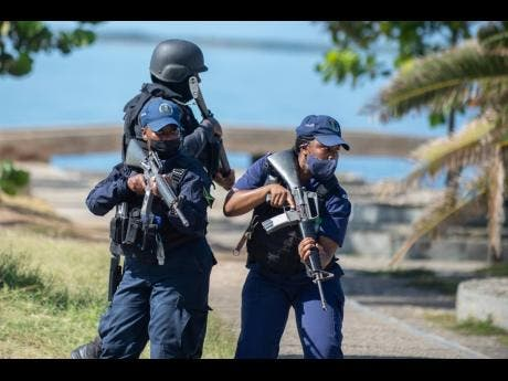 Members of the Jamaica Constabulary Force conduct a special ops training exercise at the Kingston waterfront in April.