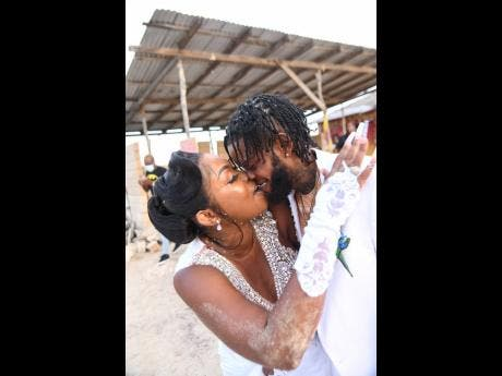 Queenie and Dowey at their 'royal wedding' at Hellshire Beach, Portmore, St Catherine.