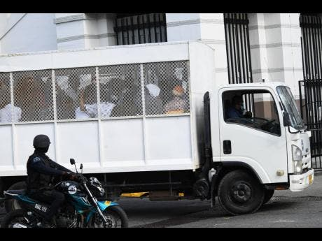 Alleged members of the One Don faction of the Clansman Gang being transported to the Home Circuit Court in Kingston.