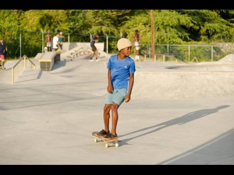 Khori Valentine, 10, takes on of his skate.