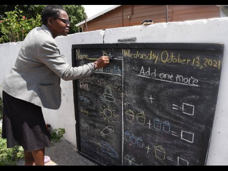 Tandeka McKoy-Phipps writes new lessons on this community blackboard.