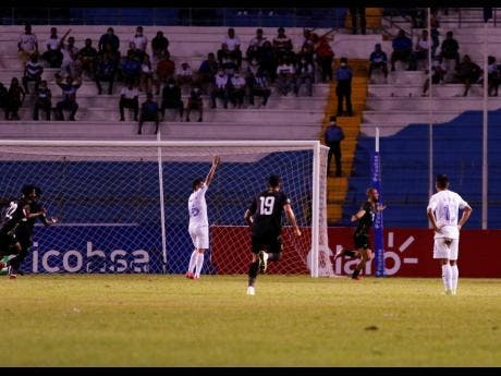 Jamaica's Kemar Roofe (second right) celebrates after scoring the opening goal against Honduras during a qualifying soccer match for the FIFA World Cup Qatar 2022 at the Metropolitan Olympic stadium in San Pedro Sula, Honduras, last night. Jamaica won 2-0.