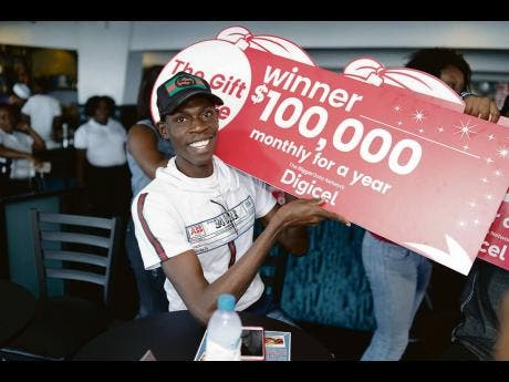 Dwight Ewen is a happy man after being one of the winners in Digicel's Christmas promotion.