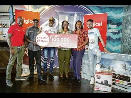Contributed Photos Digicel's Elon Parkinson (left) poses with the winners in the Digicel Christmas promotion. From second left: Raymond Bennett, Dwight Ewen, Dorrett Morgan, Sansia Stewart-Williams and Kheno Campbell.le